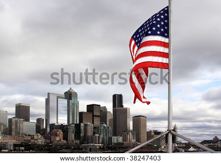 United States flag flies over city of Seattle, Washington - stock photo