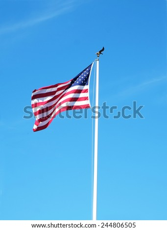 United States flag on a pole with a bright blue sky - stock photo
