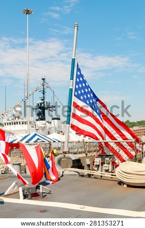 United States Flag on board Navy Destroyer - stock photo