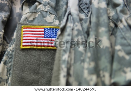 United States flag patch on the army uniform sleeve (Memorial day, Veteran's day, 4th of july, Independence day) - stock photo