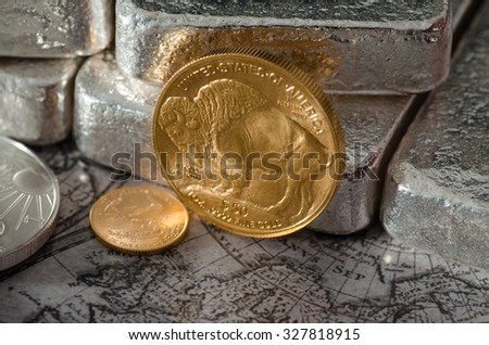 United States Gold Buffalo Coin with Silver Bars & Map - stock photo