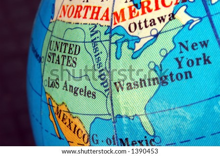 United states map on small terrestrial globe - stock photo