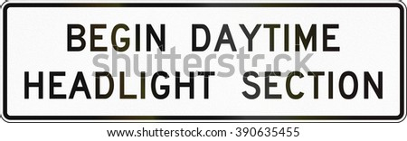 United States MUTCD road sign - Begin daytime headlight section.