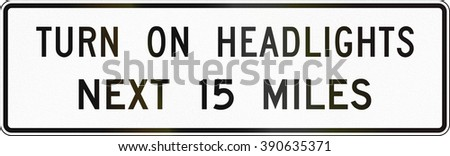 United States MUTCD road sign - Turn on headlights.