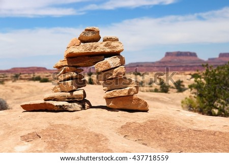 United States nature in Utah. Needles district of Canyonlands National Park. Hiking trail cairns. - stock photo