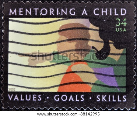 UNITED STATES OF AMERICA - 2002: A stamp printed in the United States of America shows image of a child being mentored, series, 2002