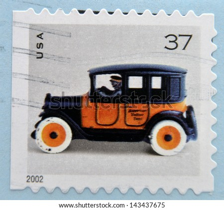 UNITED STATES OF AMERICA - 2002: A stamp printed in USA shows image of a vintage car, circa 2002