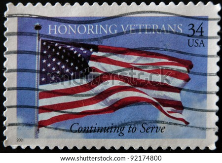 UNITED STATES OF AMERICA - 2001: A stamp printed in USA shows image of the US flag, honoring veterans, circa 2001