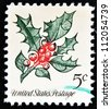 UNITED STATES OF AMERICA - CIRCA 1964: A Christmas postage stamp printed in USA show holly, circa 1964 - stock photo