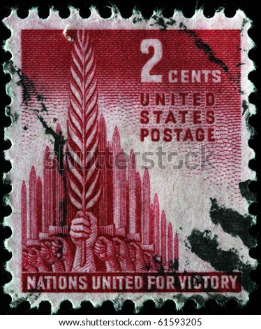 UNITED STATES OF AMERICA - CIRCA 1941: A stamp printed in the United States of America devoted United nations for defense under Hiltler, circa 1941 - stock photo
