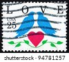 UNITED STATES OF AMERICA - CIRCA 1990: A stamp printed in the United States of America shows Love, Two Birds and Heart, circa 1990 - stock photo
