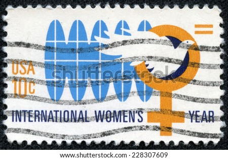 UNITED STATES OF AMERICA - CIRCA 1975: A stamp printed in the USA devoted international woman's year, circa 1975 - stock photo