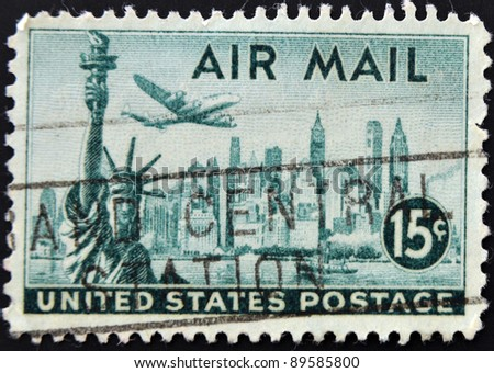 UNITED STATES OF AMERICA - CIRCA 1941: A stamp printed in the USA showing New York and Statue of Liberty, circa 1941 - stock photo