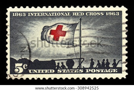 UNITED STATES OF AMERICA - CIRCA 1963: a stamp printed in the USA shows cuban refugees on S.S. Morning Light and Red Cross Flag, with inscription International Red Cross Centenary, circa 1963 - stock photo
