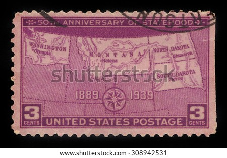 UNITED STATES OF AMERICA - CIRCA 1939: a stamp printed in the USA shows map of North and South Dakota, Montana and Washington, dedicated to the 50th anniversary of the statehood, circa 1939 - stock photo