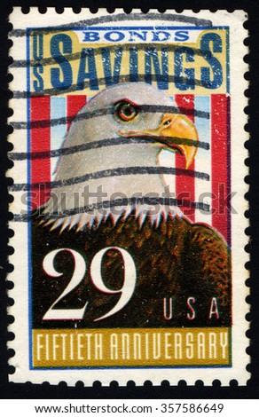 UNITED STATES OF AMERICA - CIRCA 1991: A stamp printed in USA dedicated to the 50th Anniversary Savings Bonds shows a Bald Eagle (Haliaeetus Leucocephalus), circa 1991 - stock photo