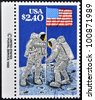 UNITED STATES OF AMERICA - CIRCA 1988: A stamp printed in USA shows Astronauts planting Flag on Moon, 20th Anniversary of First Manned Moon Landing, circa 1988 - stock photo