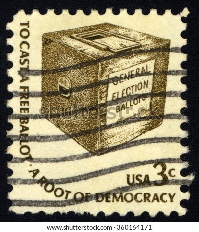 "UNITED STATES OF AMERICA - CIRCA 1975: A stamp printed in USA shows Early Ballot Box, with inscription ""To cast a free ballot - A Root of democracy"", circa 1975 - stock photo"