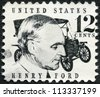 UNITED STATES OF AMERICA - CIRCA 1968: A stamp printed in USA shows Henry Ford (1863-1947) and car Ford Model T from 1909, circa 1968 - stock photo