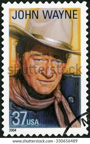 UNITED STATES OF AMERICA - CIRCA 2004: A stamp printed in USA shows Marion Mitchell Morrison John Wayne (1907-1979), series Legends of Hollywood, circa 2004 - stock photo