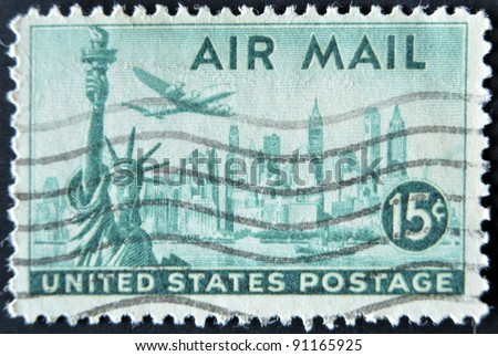 UNITED STATES OF AMERICA - CIRCA 1947: A stamp printed in USA shows plane over Statue of Liberty and New York, circa 1947