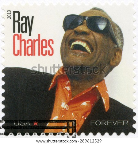 UNITED STATES OF AMERICA - CIRCA 2013: A stamp printed in USA shows Ray Charles Robinson (1930-2004), series music icons forever, circa 2013 - stock photo