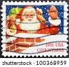 UNITED STATES OF AMERICA - CIRCA 1991: A stamp printed in USA shows Santa Claus, circa 1991 - stock photo
