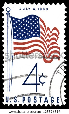 """UNITED STATES OF AMERICA - CIRCA 1960: A stamp printed in USA shows U.S. Flag, with inscription """"July 4, 1960"""", series """"America, 50 - Star Flag Issue"""", circa 1960 - stock photo"""