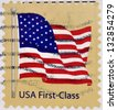 UNITED STATES OF AMERICA - CIRCA 2007: A stamp printed in USA shows waving USA flag, first-class, circa 2007 - stock photo