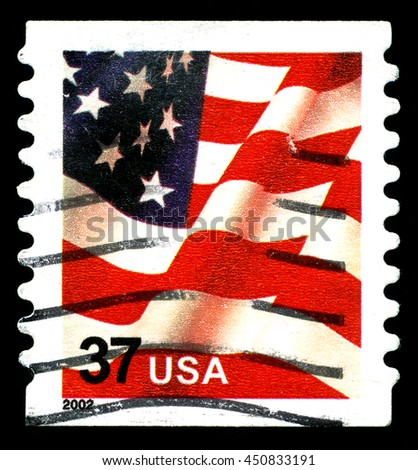 UNITED STATES OF AMERICA - CIRCA 2002: A used postage stamp from the United States of America, featuring an illustration of the Stars and Stripes of the American flag, circa 2002. - stock photo