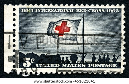 UNITED STATES OF AMERICA - CIRCA 1963: A used postage stamp from the USA, celebrating the 100th Anniversary the International Red Cross, circa 1963. - stock photo