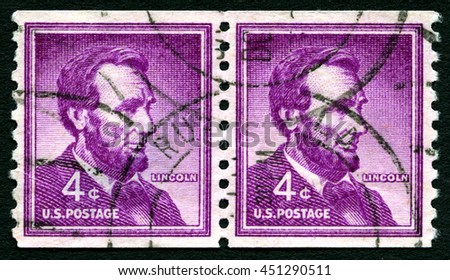 UNITED STATES OF AMERICA - CIRCA 1954: A used postage stamp from the USA depicting an illustration of historic American President Abraham Lincoln, circa 1954. - stock photo