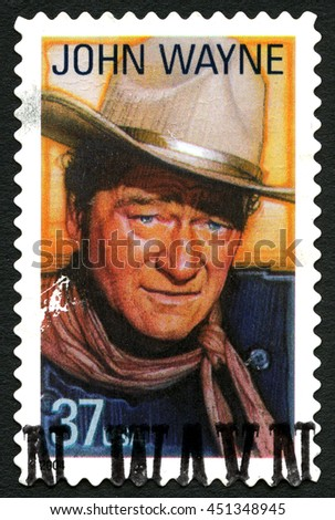UNITED STATES OF AMERICA - CIRCA 2004: A used postage stamp from the USA depicting an image of legendary actor John Wayne, circa 2004. - stock photo