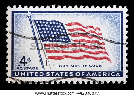 UNITED STATES OF AMERICA - CIRCA 1957: A used postage stamp printed in United States shows a flapping Flag of USA, circa 1957 - stock photo