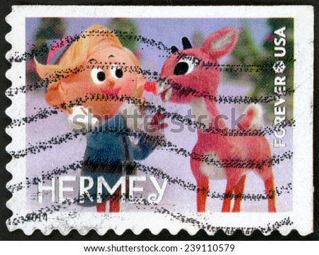 UNITED STATES OF AMERICA - CIRCA 2014: forever Christmas stamp printed in USA shows mistif elf Hermey touching Rudolph's glowing red nose from animated TV show Rudolph red-nosed reindeer; circa 2014 - stock photo