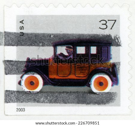 UNITED STATES OF AMERICA - CIRCA 2003: post stamp printed in USA (US) shows car toy american yellow taxicab, Scott 3641 A2816 37c orange black, circa 2003