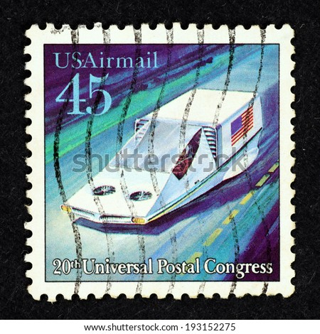 UNITED STATES OF AMERICA - CIRCA 1989: Postage stamp printed in United State of America with image of a futuristic electric delivery vehicle to commemorate the 20th Universal Postal Congress. - stock photo