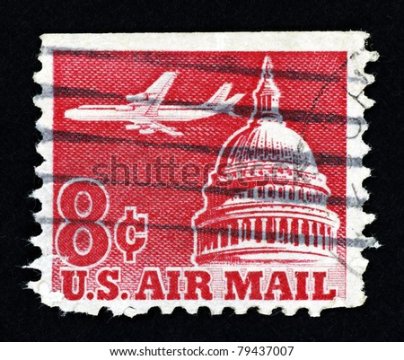 UNITED STATES OF AMERICA - CIRCA 1962 : Stamp printed in the United States of America showing an airplane flying across the Senate building, circa 1962. - stock photo