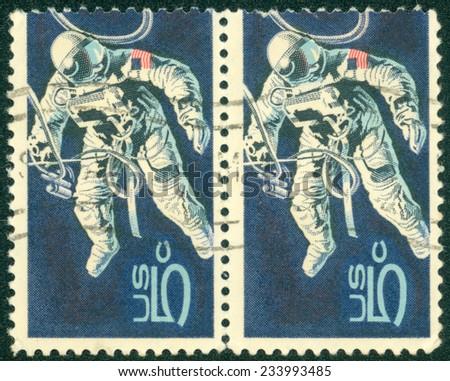 UNITED STATES OF AMERICA - CIRCA 1967: stamp printed in the United States of America shows Space-Walking Astronaut, circa 1967 - stock photo