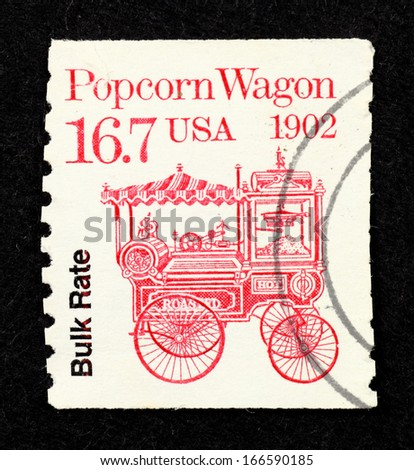 UNITED STATES OF AMERICA - CIRCA 1988: Stamp printed in United State of America with the image of a vintage red push-type popcorn wagon, circa 1988. - stock photo