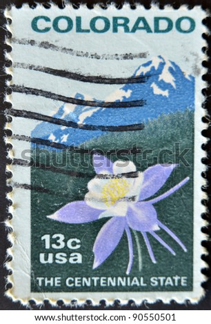 UNITED STATES OF AMERICA - CIRCA 1977 : stamp printed in USA, shows Colombine flower and Rocky Mountain, circa 1977 - stock photo