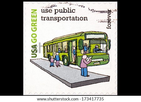 UNITED STATES OF AMERICA - CIRCA 2014: stamp printed in USA shows Go Green use public transportation USA forever, circa 2014 - stock photo