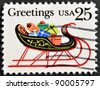 UNITED STATES OF AMERICA - CIRCA 1989: stamp printed in USA, shows sleigh full of presents, circa 1989 - stock photo