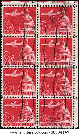 UNITED STATES OF AMERICA - CIRCA 1962 : Stamps printed in the United States of America shows an airplane flying across the Senate building, circa 1962 - stock photo
