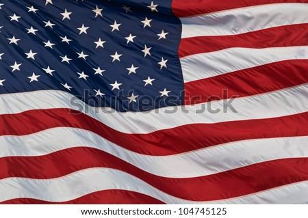 United States of America flag. Image of the american flag flying in the wind. - stock photo
