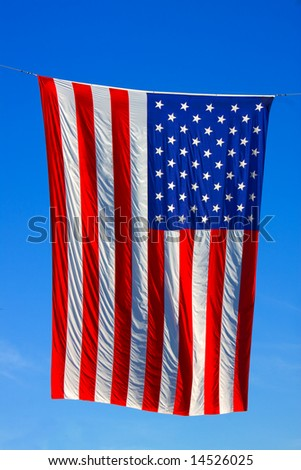 United States of America flag with blue sky background - stock photo
