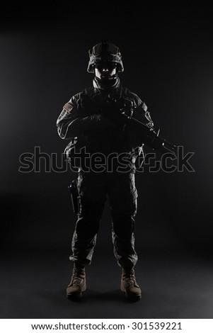 United States paratrooper airborne infantry studio shot on black background - stock photo