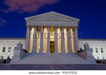 United States Supreme Court at night in Washington, DC - stock photo