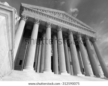 United States Supreme Court building in black and white.
