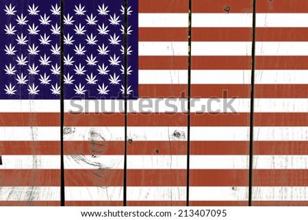 United States with Leaf of Marijuana Flag on wooden background  - stock photo